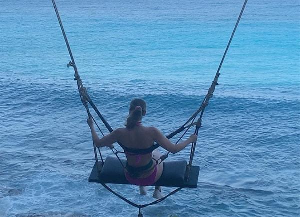 Diamond Beach Girl on Swing Nusa Penida in Bali