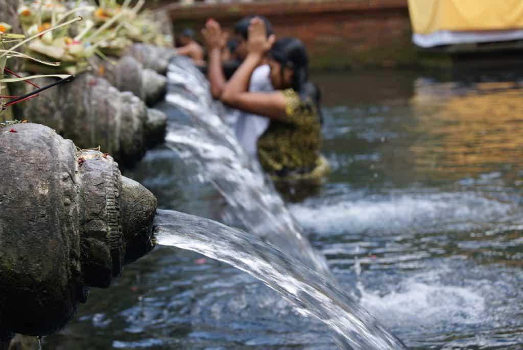Tirta Temple Praying in Holy Water in Bali