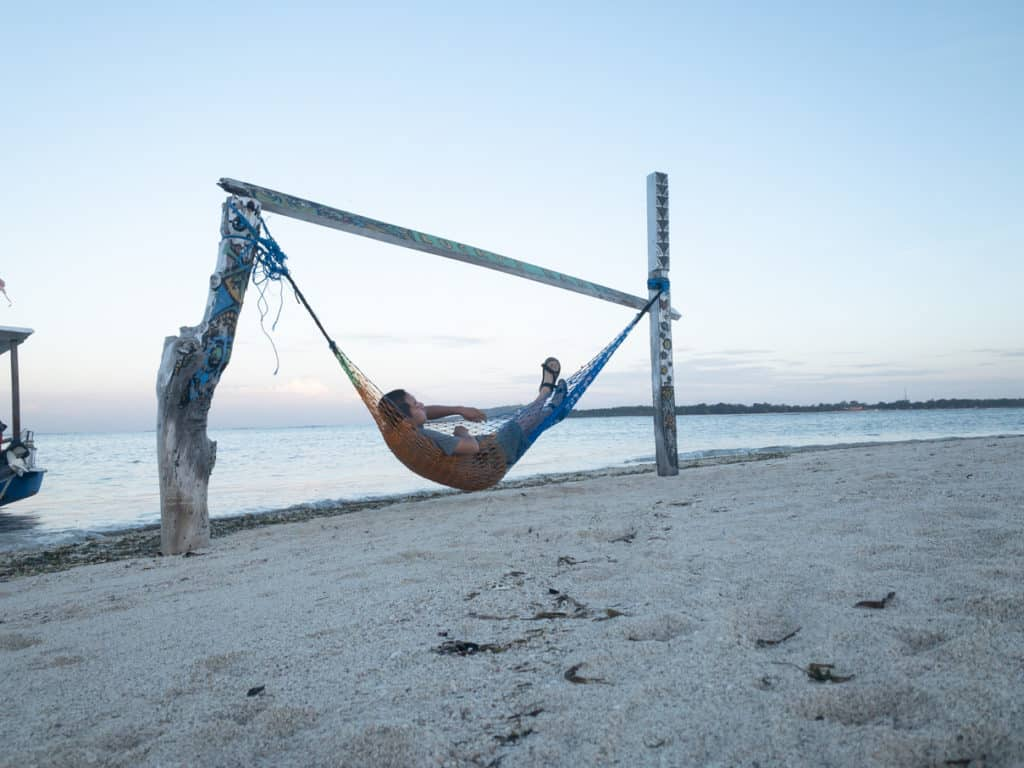 Hanging on a hammock on the beach at sunrise in Gili Air