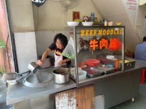 Unidentified lady making Beef Noodle Soup in Kuala Lumpur