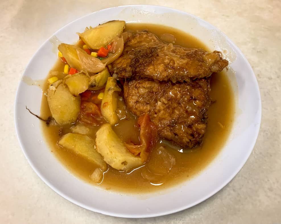Fried Chicken Chop dish with roasted potatoes in Kuala Lumpur