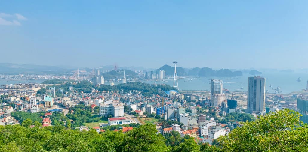 View of Ha Long City from a viewing tower mid-afternoon on a sunny day in Vietnam.