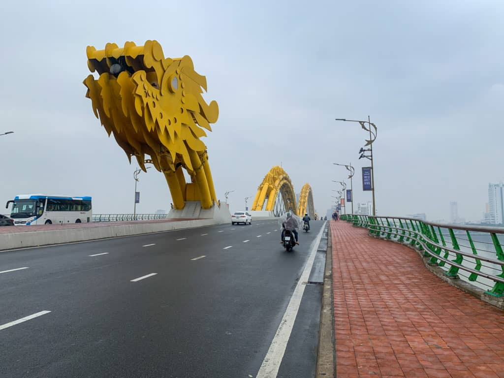 Dragon Bridge in Da Nang City, Vietnam is a very iconic bridge as commuters drive by on a foggy day.