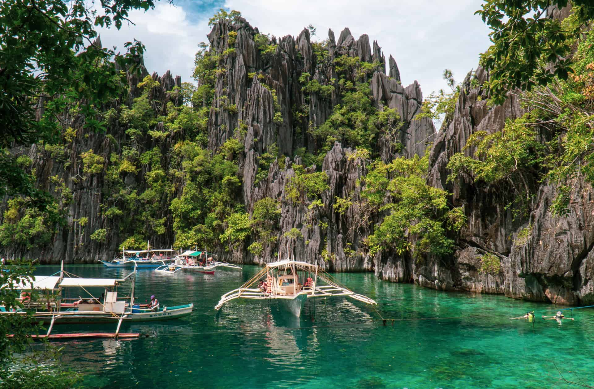 Clear water at Twin Lagoon with bangka boats  anchored in Coron, Palawan,Philippines