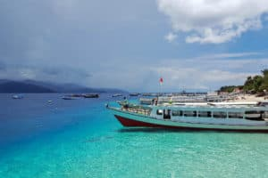 Profile view of a ferry boat in Gili Island with clear aqua blue ocean water in Indonesia