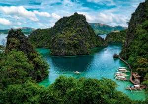 Kayangan Lake viewpoint overlooking aqua green bay in Coron Philippines