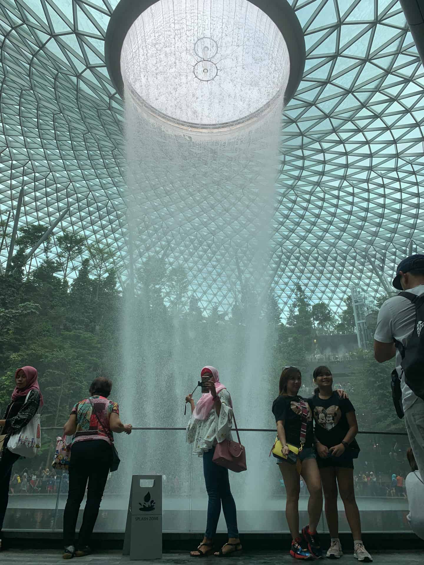 Woman takes selfie at the Jewel in Changi Airport Singapore